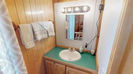 A vanity and sink is also available for getting ready for bed or getting ready for your day exploring Yellowstone.