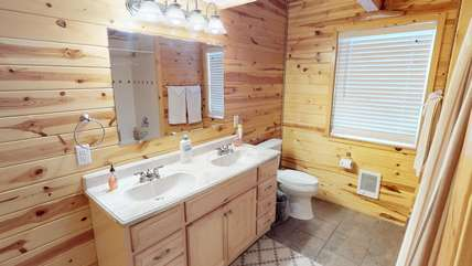 The bathroom on the main level which includes double sinks.