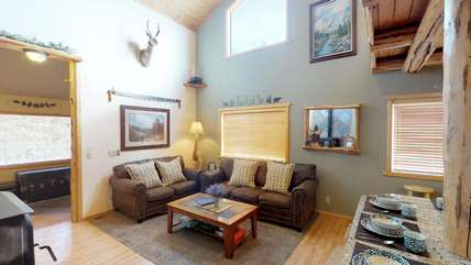 This living room also offers comfy couches to relax after your adventures in Yellowstone.