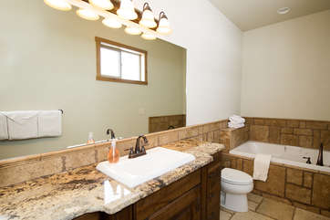 The master bathroom is the perfect place to run a nice warm bath to jump into after playing at the reservoir.