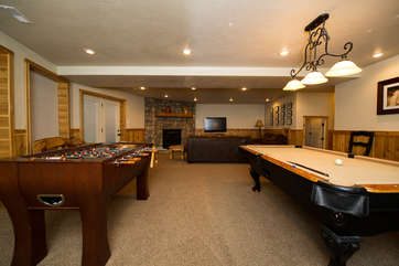A pool table and fooz ball table are perfect to keep everyone happy and entertained.