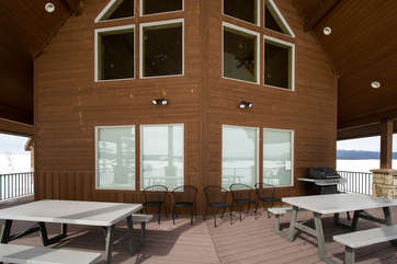 The front deck provides plenty of seating and a barbecue for all your grilling needs.