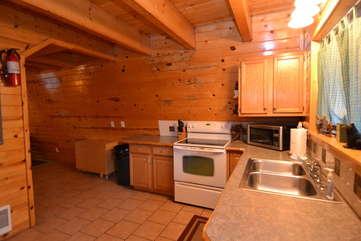 Kitchen has full size appliances