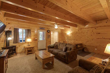 beautifully decorated in a woodsy mt. theme and also has a dining table area.