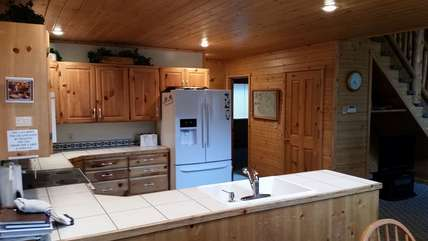 Fully equipped kitchen with plenty of dinning and cookware