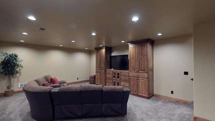 The basement living room is the perfect place to watch a movie.