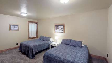 The first bedroom located in the basement has two queen beds.