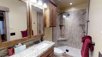 The master bedroom also has it's own private bathroom with double vanities and a gorgeous tiled shower.
