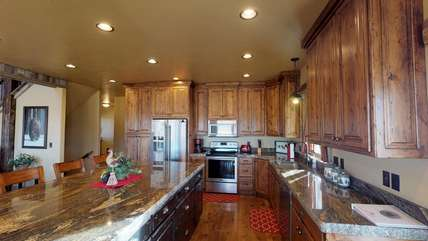 Not only is the kitchen gorgeous it has anything that you might need to cook up a delicious meal.