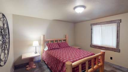 The second queen bedroom located upstairs.