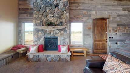The gorgeous rocked fireplace is the best place to warm up.