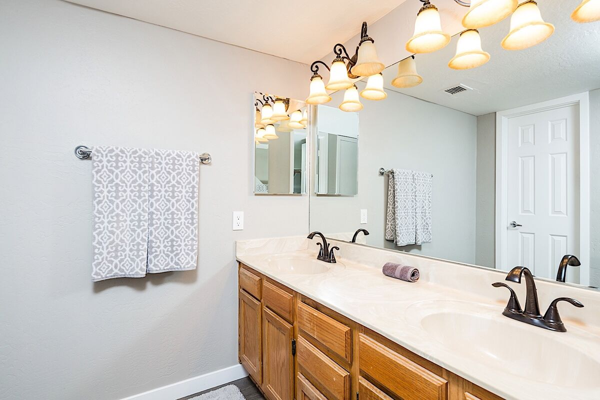 A double vanity in the master bathroom means no knocking elbows while you get ready for your next adventure.