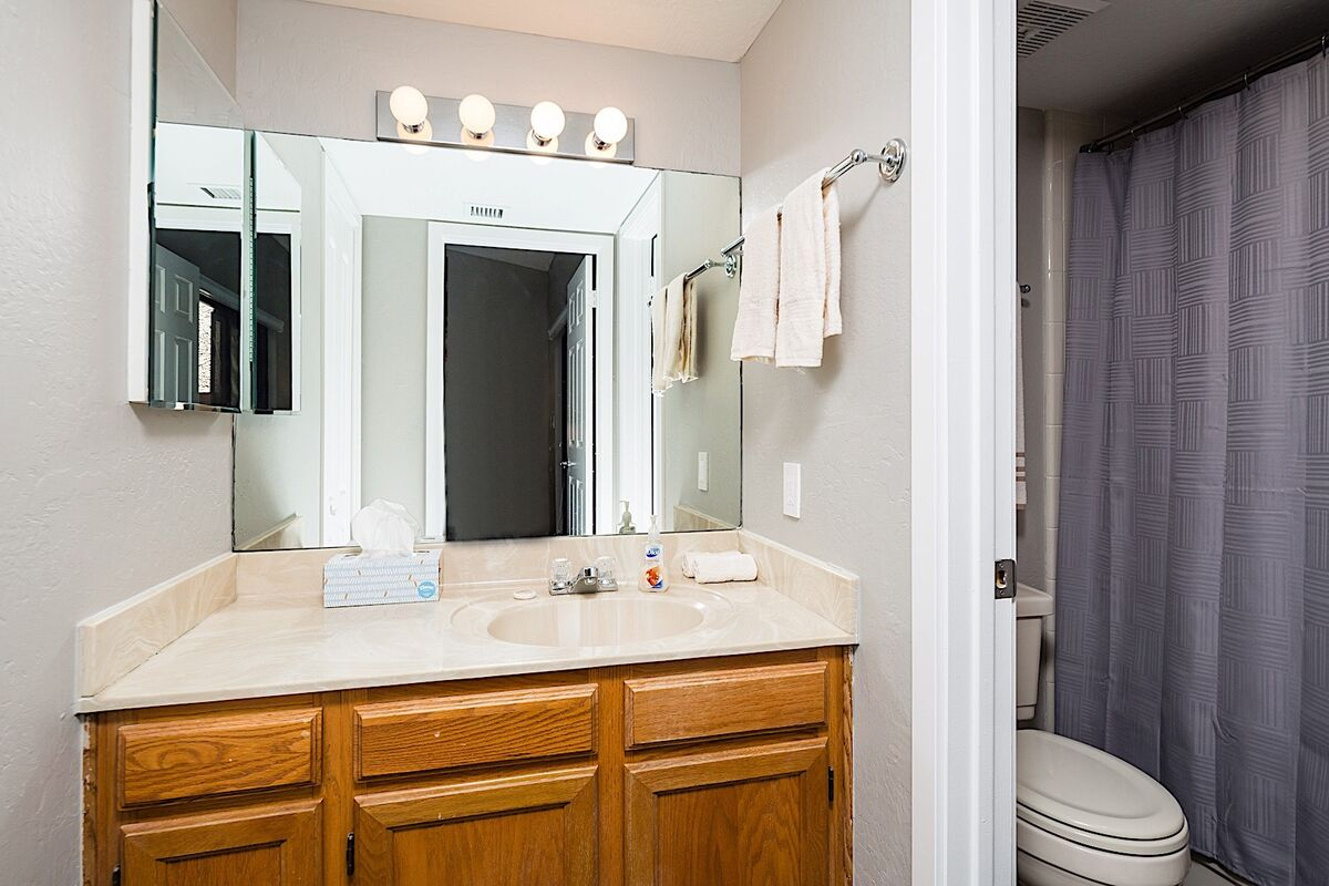 The second bathroom has added privacy with a door separating the sink and shower areas!