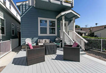 Cute outside hangout area with gas BBQ and sitting area.