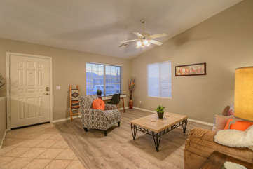 Floor plan is open and bright with vaulted ceilings and ceiling fans throughout
