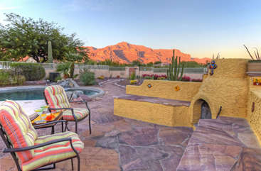 Experience tranquility in front of wood burning fireplace with appreciable views of Superstition Mountains