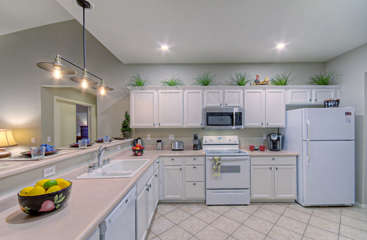 Kitchen cabinets are newly refinished and filled with all the gadgets and conveniences the chef desires