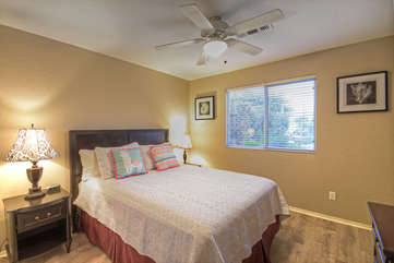 Second bedroom with queen bed and television offers private sleeping quarters thanks to well designed split bedroom floor plan