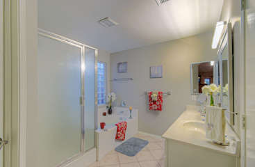 Lovely master bath includes sumptuous garden tub and walk in shower