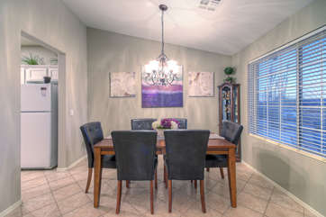 Dining room is at front of home and offers picturesque views of front yard and beyond