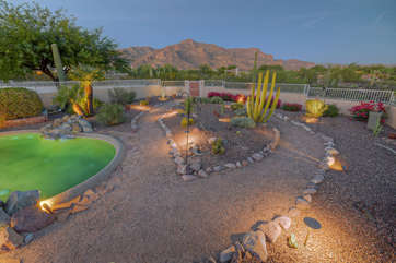 Seasonal color, outdoor fountain and spectacular views of the Superstition Mountains add charisma to amenity-rich backyard
