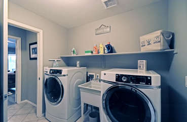 Completely stocked laundry room keeps chores simple and quick
