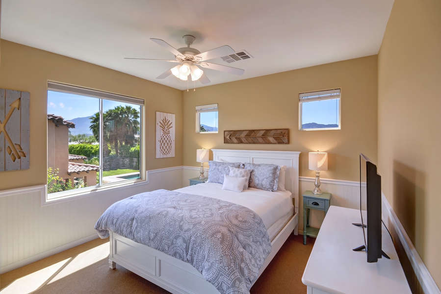 Guest bedroom 3 with queen bed and mountain views