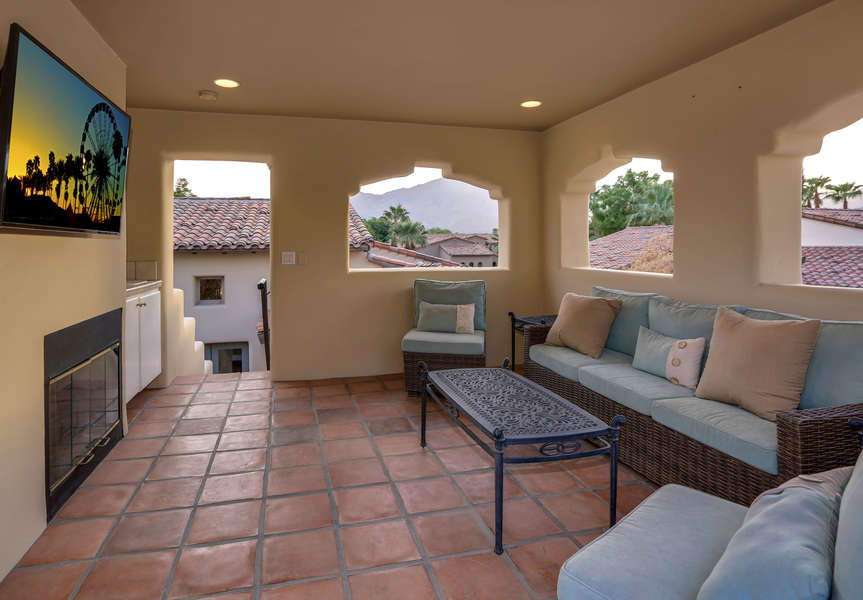 Upstairs terrance with lounge seating, TV and amazing golf course views.