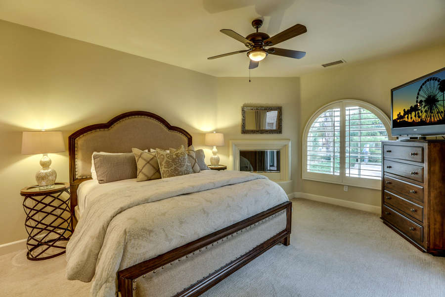 Casita bedroom with king bed, TV, sink area, private entrance and fireplace