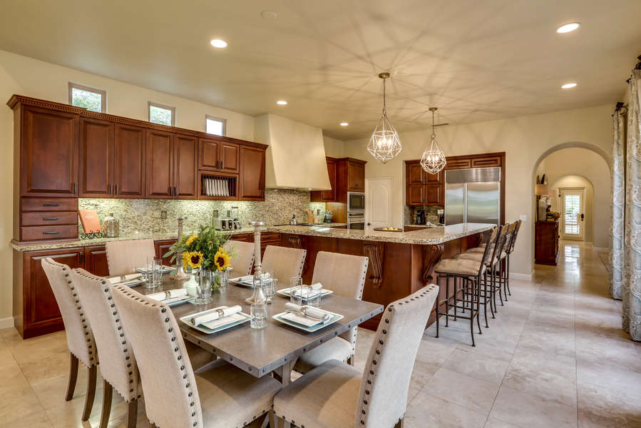 Open concept kitchen that opens to dining and the living room