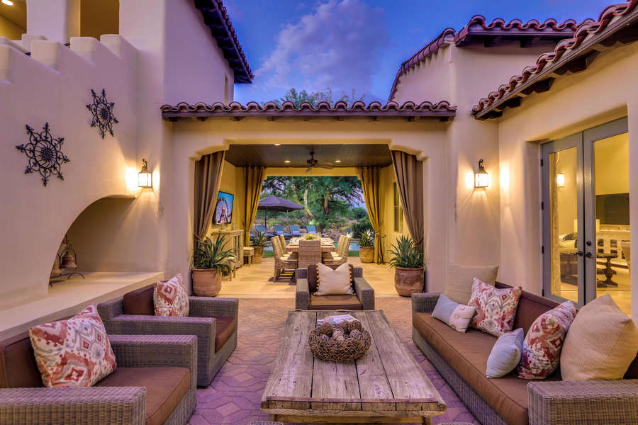 Nighttime private courtyard with comfy seating