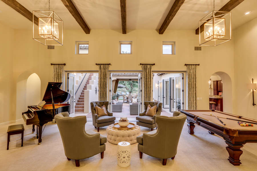 Game room with billiards, grand piano and seating