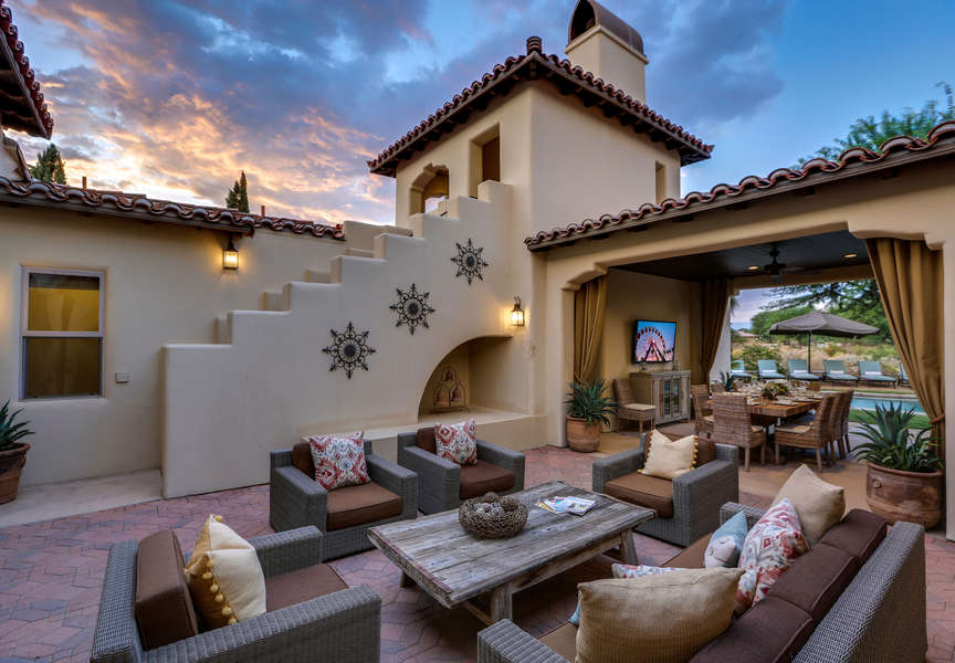 Private interior courtyard with lounge seating and direct access to various rooms in the home