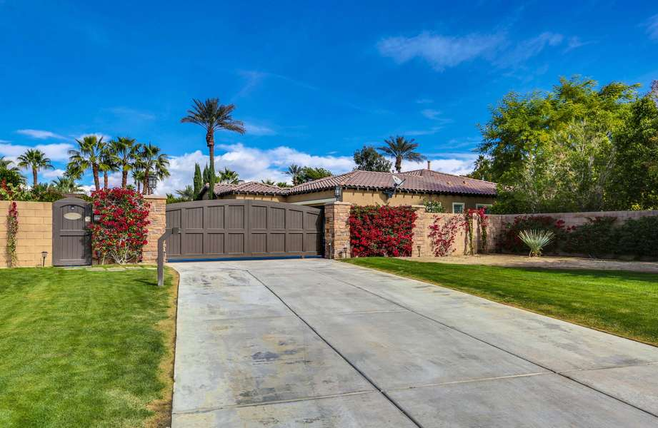Private gated entrance and oversized driveway