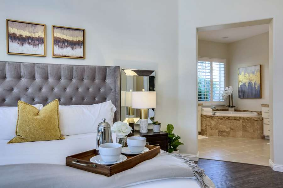 Master bedroom suite with king bed, desk and large HDTV
