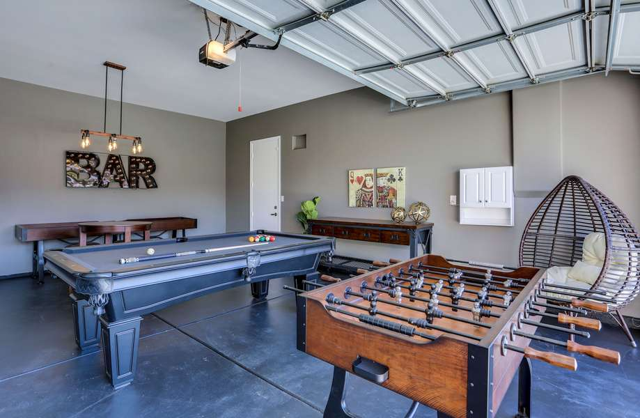 Game room with pool table, ping pong, foosball, shuffle board and game table w/seating