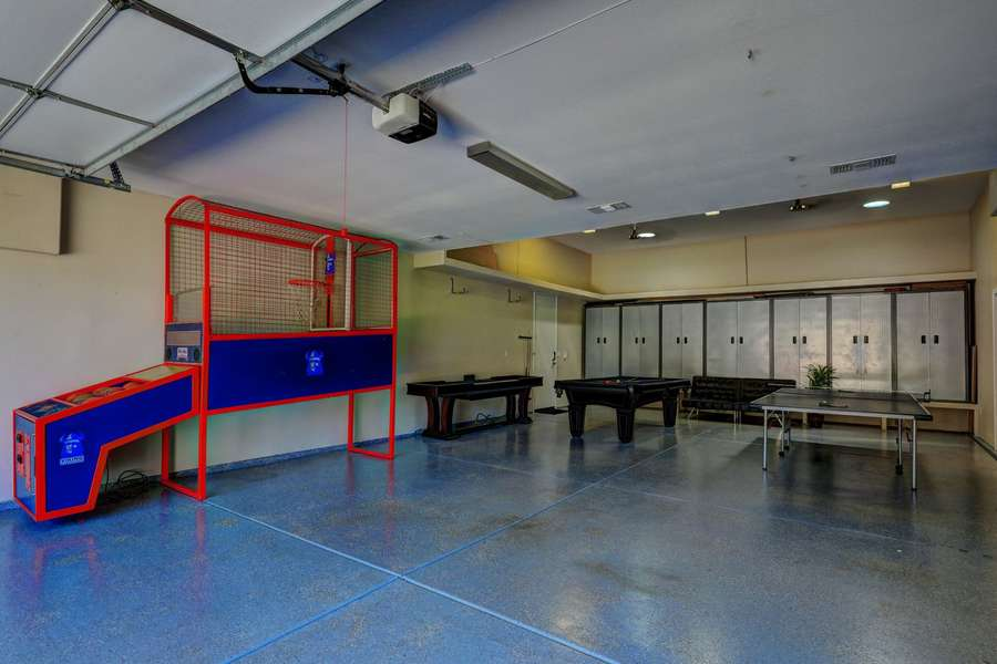 Full air conditioned game room with basketball shooter, shuffle board, billiards and ping pong!
