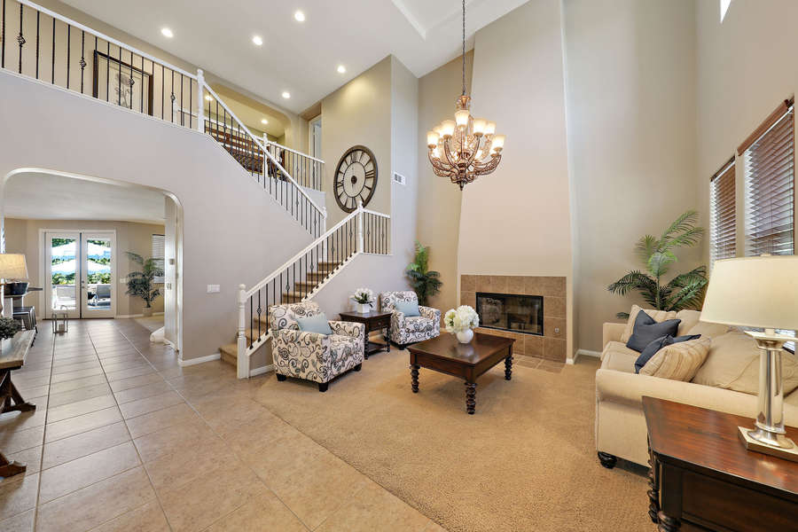 Grand formal living room with fireplace and vaulted ceilings for a bright and fresh space