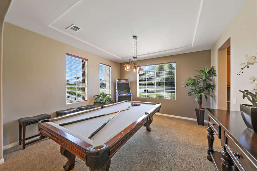 Indoor game room with billiards and multi-game arcade.