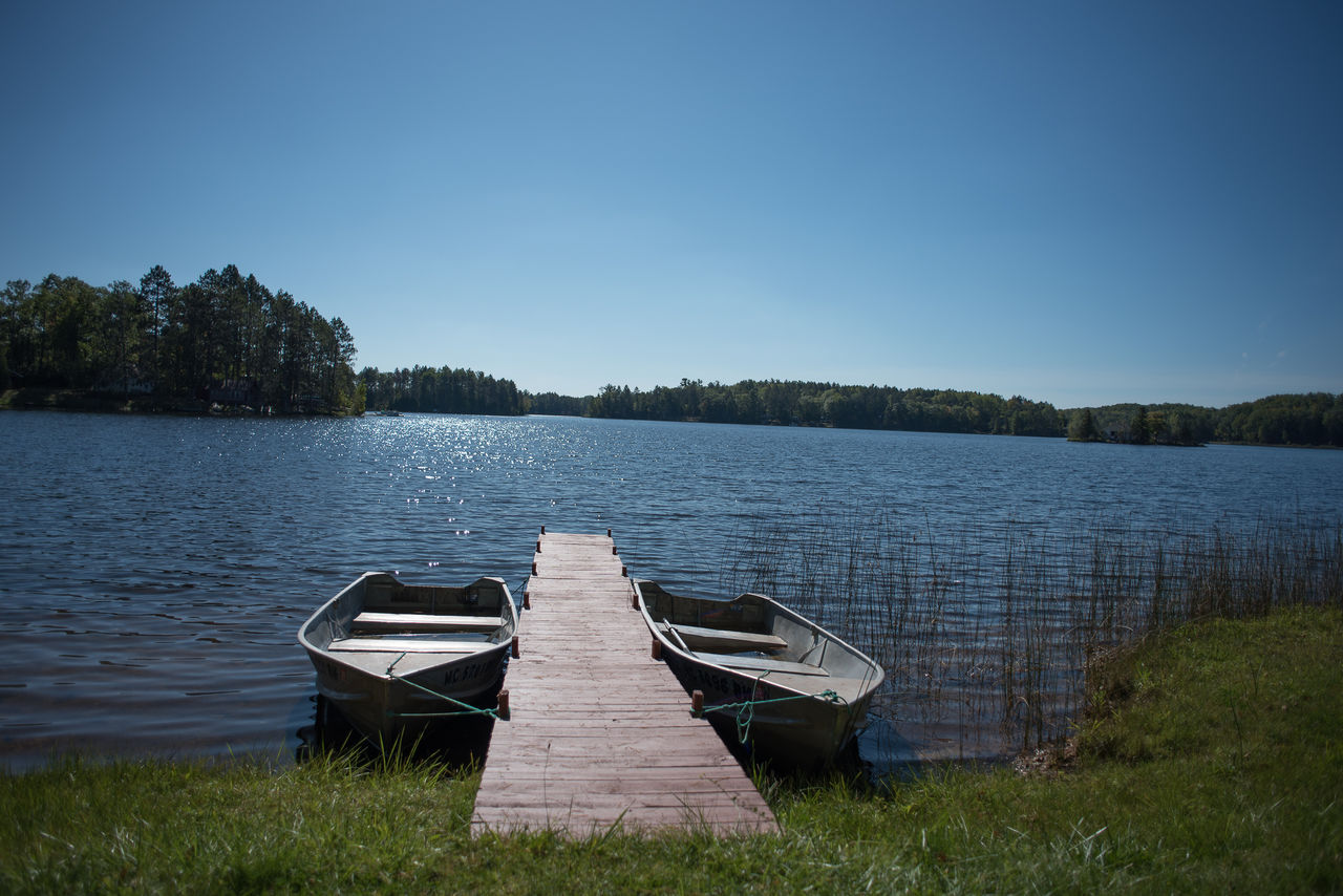 Nestled boats waiting for you to enjoy Lake Nettie!