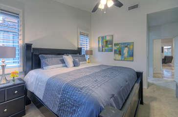 Enjoy sweet dreams on deluxe king bed in elegant master suite on first floor