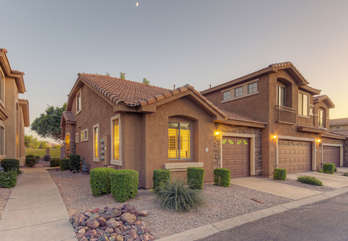 Pretty home with private side entrance and one car garage awaits your arrival