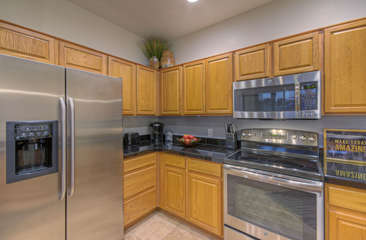 Kitchen has appealing workspace and layout for preparing and serving mouthwatering cuisine