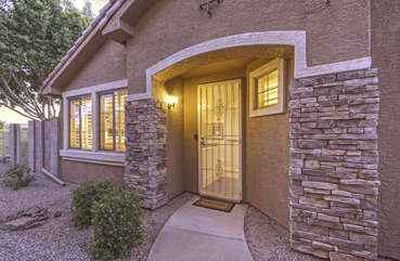 Charming entrance to your home away from home in quiet, gated community