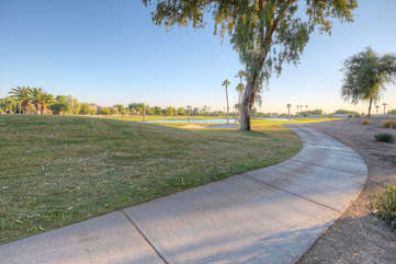 Look over or through the back fence and enjoy this exciting golf course view that includes water features and green spaces