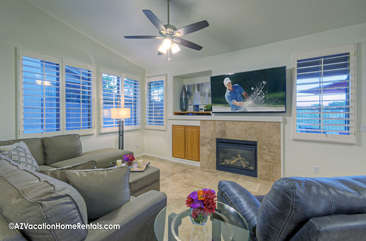 Modern, newly furnished great room with large television and gas fireplace is comfortable place to relax with your favorite people