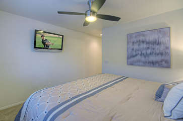 Upstairs master bedroom also has king bed and large television