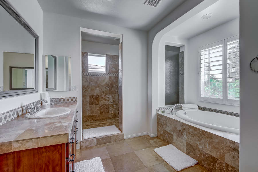Master bedroom en suite bath with double vanity, walk in shower and soaking tub