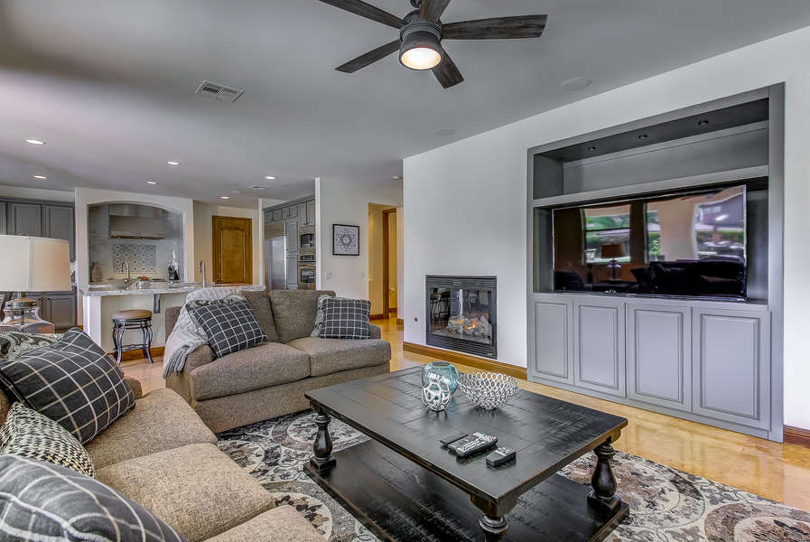 Living room with comfortable sofa seating and large HDTV for entertainment