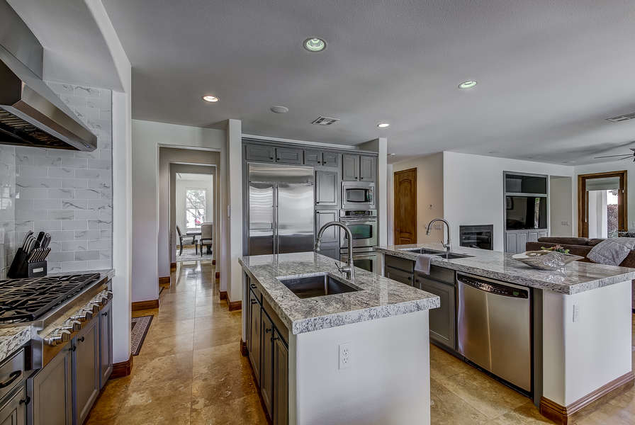 Newly remodeled and upgraded chef's kitchen with stainless steel appliances and double kitchen islands